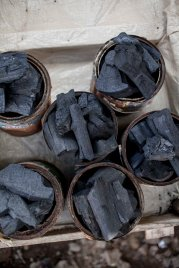 Neatly packed rations of charcoal for sale.